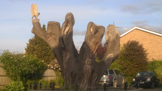 Alconbury, UK: Carved tree in garden 1