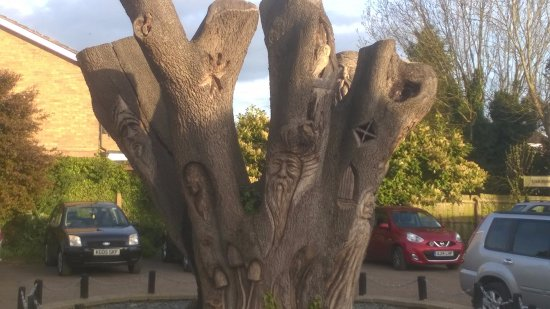 Alconbury, UK: Carved tree in garden 2