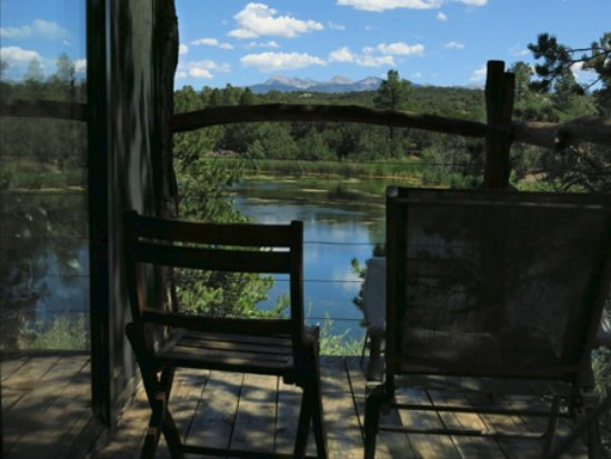 Abode at Willowtail Springs: Bungalow Cabin deck looking at lake and mountains