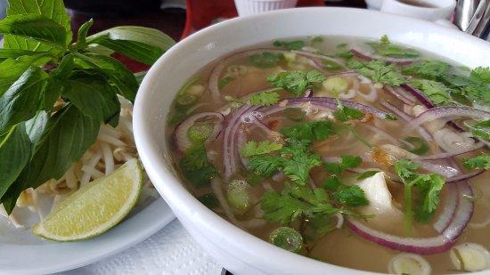Chicken Pho noodle soup, fresh basil, sprouts & cilantro