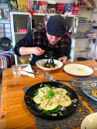 Kyneton, Australia: Mushroom ravioli with white wine and tarragon sauce & that is a squid ink fettucine being enjoye
