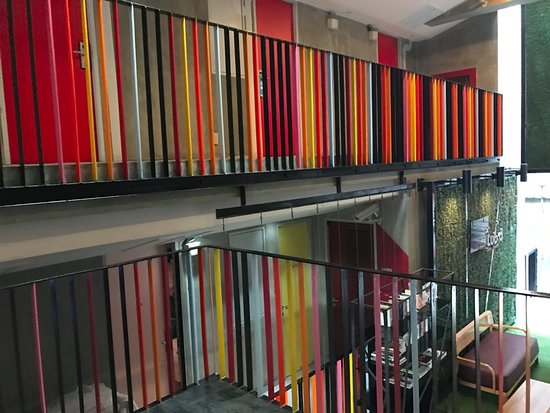 Lub d Bangkok Siam: colorful rails overlooking 1st floor.