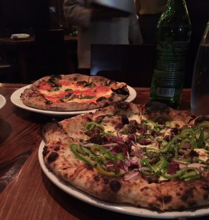 Domenica: Foreground: Smoked Pork Pizza and Background: Margherita Pizza