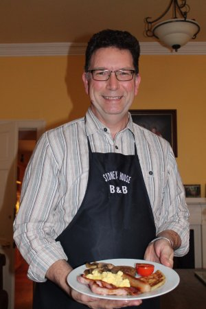 "Cromarty, UK: Sydney House B&B host Alasdair Matheson ""presenting breakfast."" (And absolutely delicious it was"