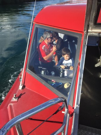 Taupo, New Zealand: My son enjoying drivin the boat