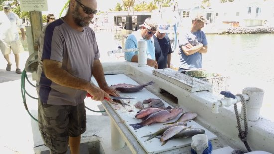 Long Key, FL: What a great day on Something Catchy! Getting the fish filleted