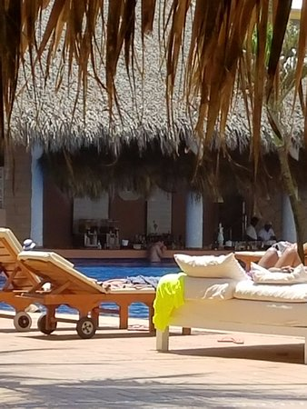View of the in-pool bar from pool-side lounger