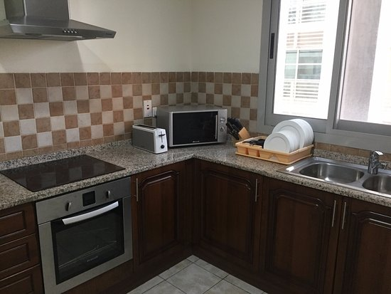Kitchen Is Extremely Well Furnished With Microwave Induction Oven
