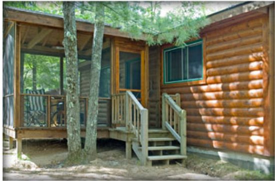 Lac du Flambeau, WI: Hilltop cabin has a lovely screen porch view of the lake