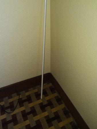 Sulphur, LA: Curtain rod in the corner of the room