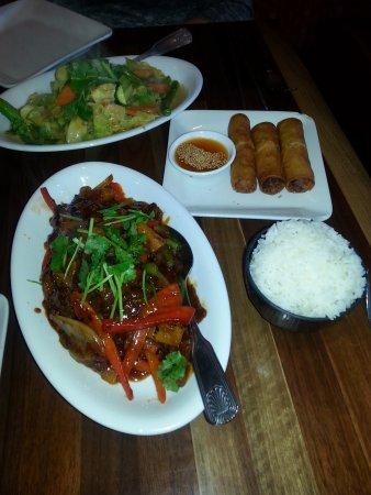 Pleasanton, CA: Szechuan Beef and Vegetable platter with vegetable egg rolls.