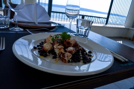 Kastel Luksic, Croacia: Always interesting octopus with sauteed black beans in dried tomato and basil emulsion
