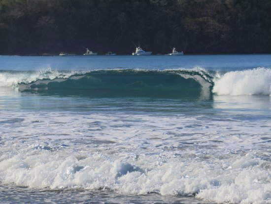Nicoya, Costa Rica: Surf with view toward boats moored in bay.