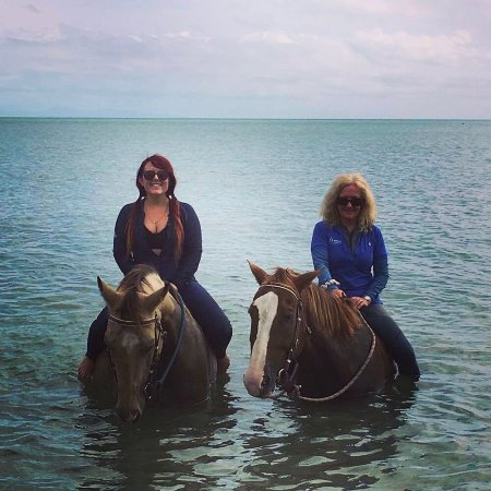 Magnetic Island, Australia: My daughter and me bareback in the ocean.