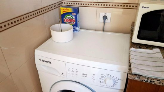 Washing machine with included clothes pegs and wash powder