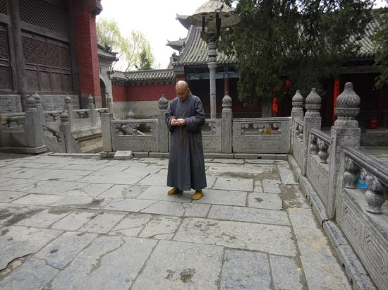Dengfeng, China: Is the Monk looking at his phone? :)