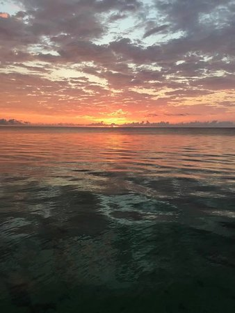 White Sands Cove Resort: Sunrise from the pier
