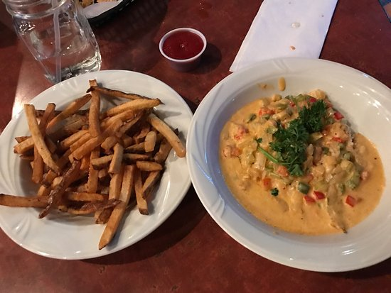 Salina, KS: Pulled pork sandwich, delicious fries, crawfish étouffée and the best fried pickles ever!