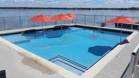 Graford, TX: Lakefront swimming pool, surrounded by the lake and heated during nice spring weekends!