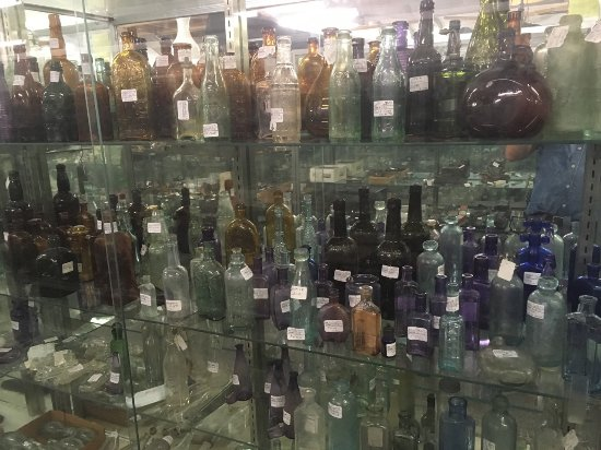 Lake City, FL: bottles in glass display cases