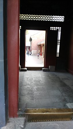 Lama Temple (Yonghegong) Bottom part of door frame (gold color in this & Bottom part of door frame (gold color in this photo) NEVER step on ...