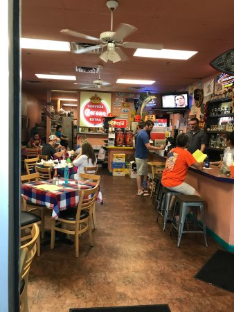 Amigos Cafe Y Cantina: Laid back and unpretentious. It's all about the food and if you like a margarita with enough gut