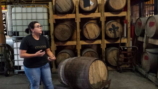 Old New Orleans Rum Distillery: Our guide talking about the barrels used in the distilling process.