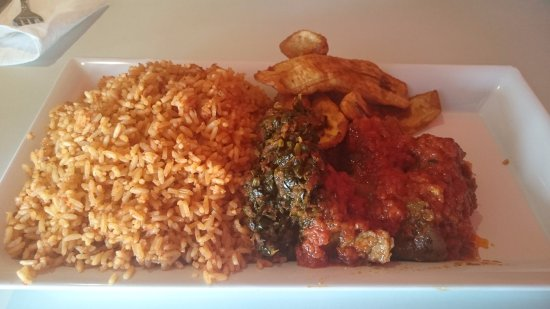Jollof rice with goat meat and fried plantain