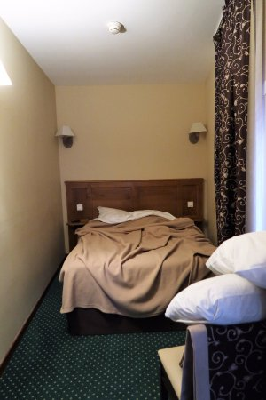 Hotel Heliot : Area letto (stanza al primo piano)