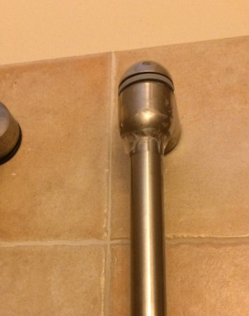 Newcastle, Nevis: Shower fitting held together with sellotape (scotch tap)