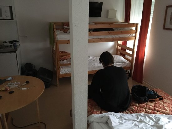 Le Grand Hotel de Munster : The 4-person room. The TV was IN the upper bunkbed. Really small room for 4 adults...