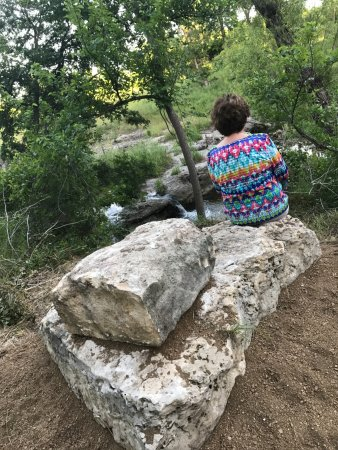 Lampasas, TX: person resting on a stone bench