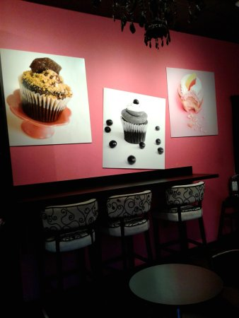 Wal and seating area inside Cupcake a la Mode