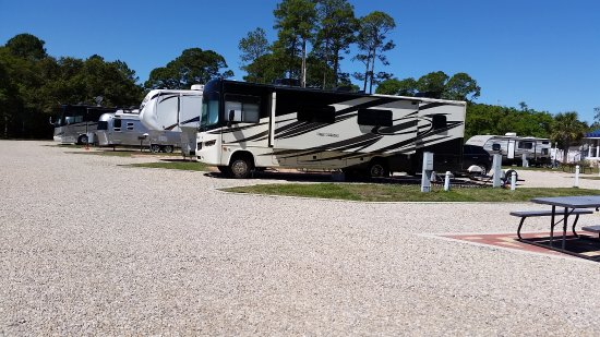 Eastpoint, FL: Spacious sites with grass and paving tiles, tbles, etc.