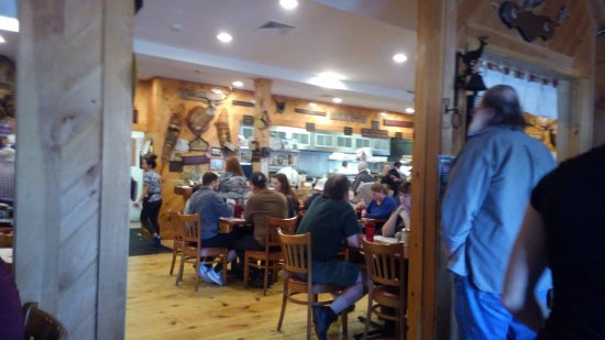 Lancaster, Массачусетс: a view of the kitchen and dining area, and a buck on the wall