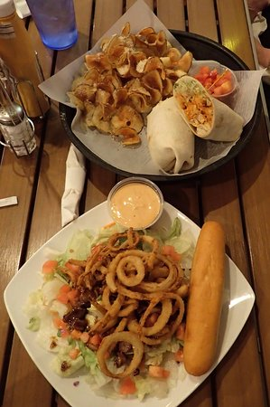 Manson, IA: Buffalo chicken wrap with ribbon fries and riptide steak salad.