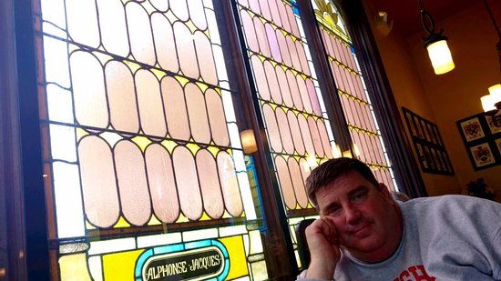 The Holy Grail: We sat by the stained glass windows and tried it all,from appetizers to dessert. Great place.