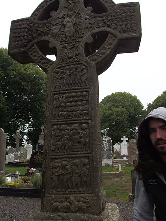 County Louth, Ireland: View of a High cross with our tour guide
