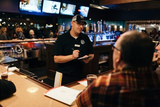 Wausau, WI: Enjoy a drink and watch the game at our Curly's Pub bar!