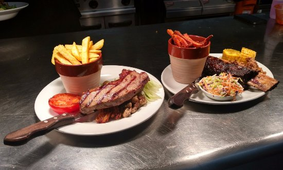 Brackley, UK: Two delicious dishes: the Black Angus sirloin steak, and the Rib of Beef with Pulled Pork.