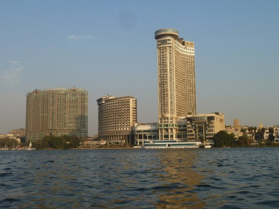 Four Seasons Hotel Cairo at Nile Plaza: Four Seasons and other hotels on the Nile. Taken while on a felluca.
