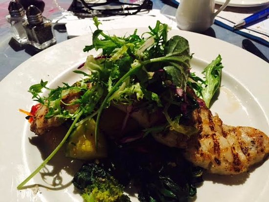 Red Fish Grill: Grilled Bay Snapper on top of sauteed vegetables