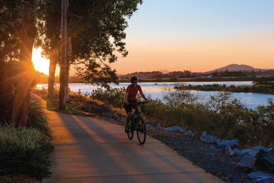 Mackay, Australia: Cycling along the Bluewater Trail at sunset beside the Pioneer River.
