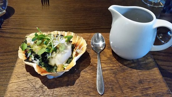 Moira, UK: scallop cooked over coal, seaweed and dashi