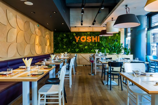 Yoshi Sushi and Teppanyaki: Inside the restaurant, you will find a vibrant atmosphere.