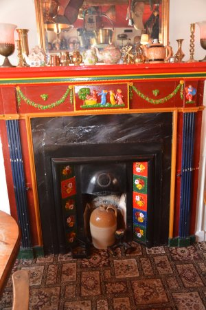 The Folly Inn: traditional canal art fire place