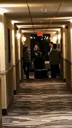 Barrington Hotel & Suites: This was the kids parents having happy hour in the hall outside my room