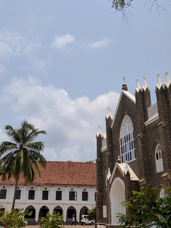 St. Andrew's Basilica Arthunkal: Low clouds floating over the structure.