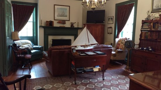 The Inn at Mitchell House: One of the two parlors to gather, relax and explore