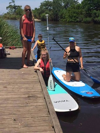 Hahnville, LA: Kids enjoying how to stand up paddle board on bayou LaBranch